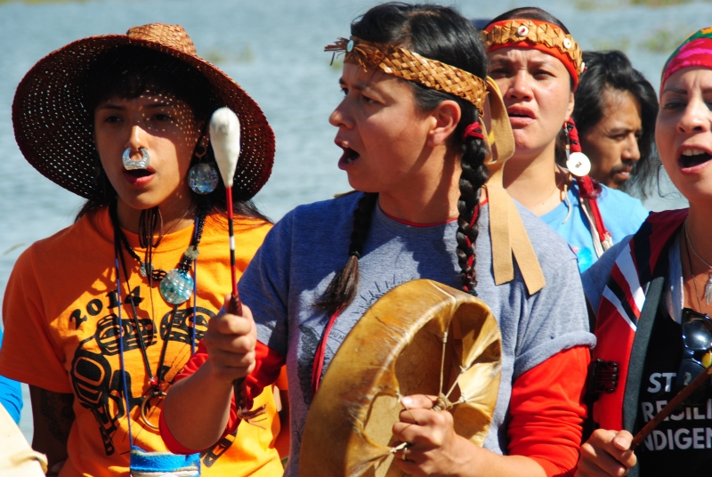 Activists singing alongside Misouri River