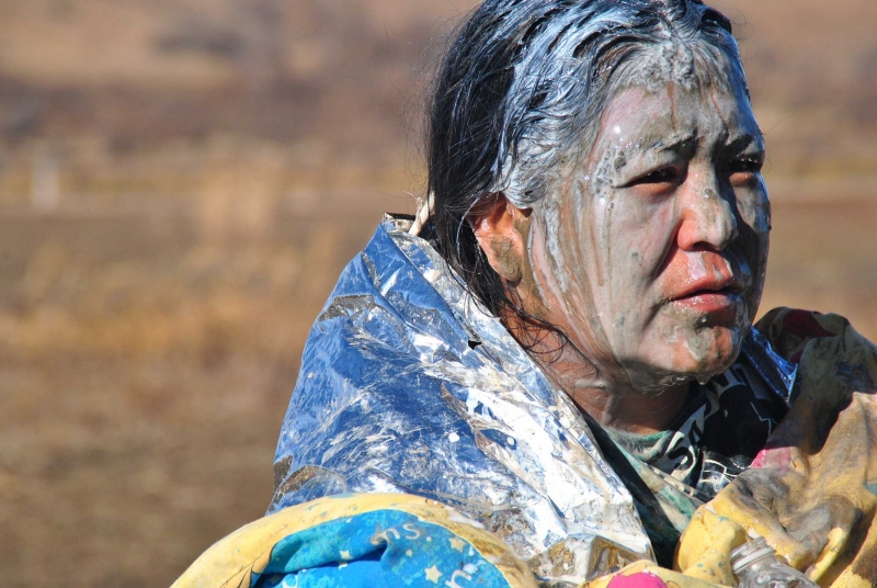 Elderly native woman sprayed by mace, at medics - photo by C.S. Hagen