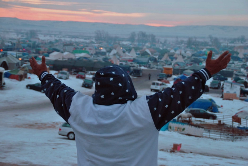 Good morning prayers at Standing Rock - photo by C.S. Hagen