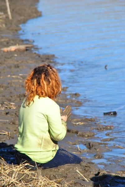 Activist praying at Cantapeta Creek - photo by C.S. Hagen