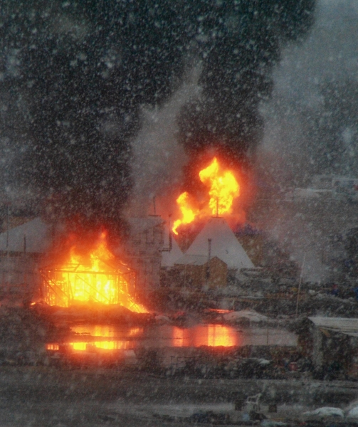First structures set ablaze at the Oceti camps February 22 - photo by C.S. Hagen