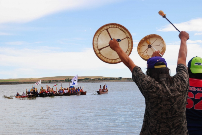 Ronald and Eric Day, from Washington, hailing departing canoes along the Misouri River