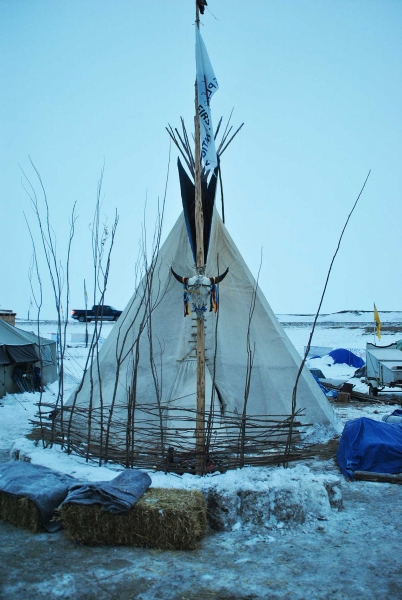 Tipi at Oceti Sakowin, surrounded by hay bales, tipis are far warmer than tents - photo by C.S. Hagen
